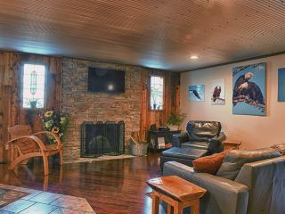 Living room with leather furniture, electric fireplace insert, 42' Flat screen T.V. & much more