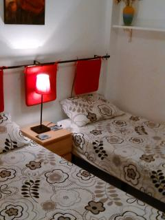 Two single beds with air con and ceiling fan