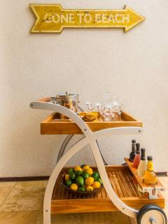 1503 Surfrider - A teak bar cart is available for you to stock at 'Your Own Private Paradise'