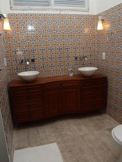 The master bathroom is spacious and elegant, with double sink and walk-in shower.