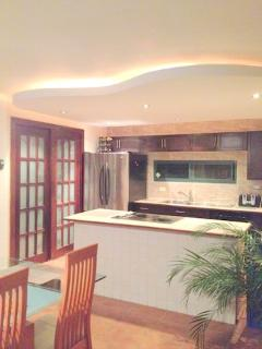 The modern kitchen comes fully equipped with stove, oven,fridge,cooking tools, plate ware, stem ware
