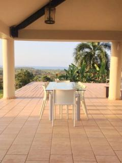 Outdoor Dining with seating and for 10 people. The outdoor kitchen island seats 6 more. Ocean Views!