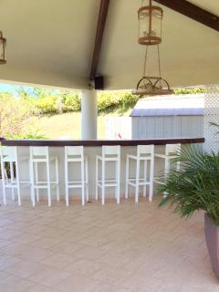 The outdoor kitchen/BBQ area has seating for 6 at the counter.Large propane grill included.