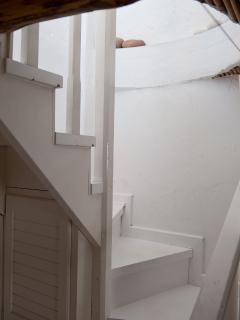 The stairs that leads to the first floor