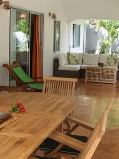 Oceanview Terrace with rattan furniture and 12 seater teak dining table