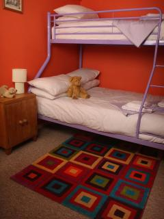The second bedroom with triple sleeper bunk bed