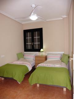Generous single beds, large ceiling fan and ample wardrobe space