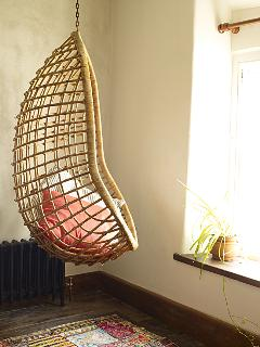 SIt and read or watch the world go by in our original sixties hanging chair.