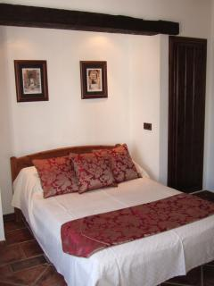 master bedroom, with double bed and deluxe mattress