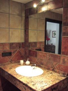 Fully tiled complete with granite vanity unit ensuite bathrooms