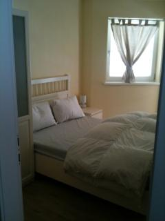 bed 2 with wardrobe & balcony