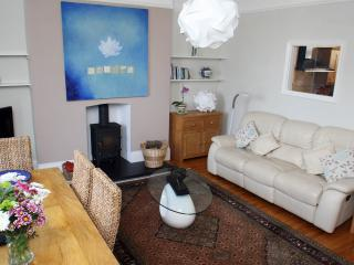 The living room is spacious and seats 6 people comfortably