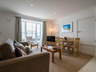 Large lounge and window with fantastic views of Porthminster Beach and the sea