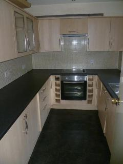 Modern kitchen, with microwave (not pictured), kettle, oven, toaster, ketter, fridge & freezer