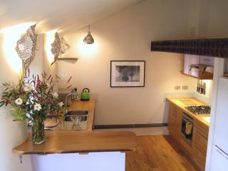 The Piggery kitchen with its maple work tops and everything you may need to enjoy your stay