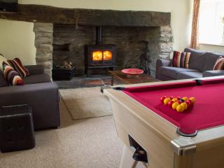 Enjoy a game of pool or relax in front of the log burner