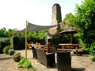 The wonderfully private walled courtyard with huge outdoor working fireplace.