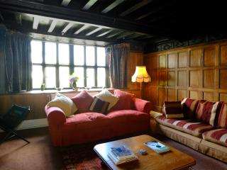 The C17th, historic, oak panelled drawing room at Middle Coombe Farm