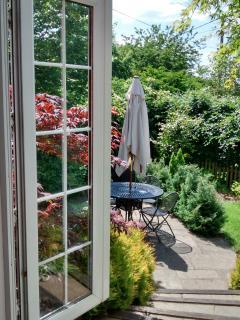 patio doors lead to garden terrace area