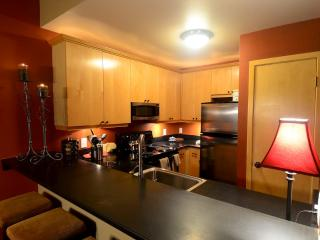 Kitchen with granite counters, nice appliances, fully stocked