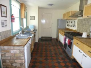 Large well equipped kitchen with original tiled floor