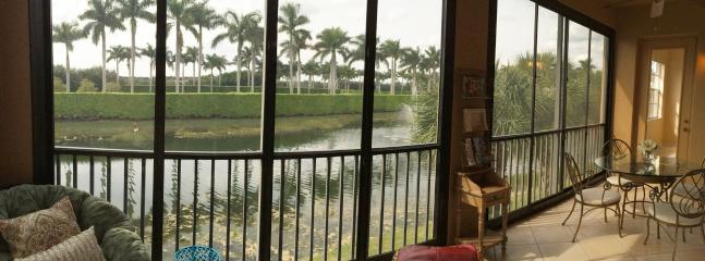 Private lanai overlooking beautiful  surrounded by Royal palms