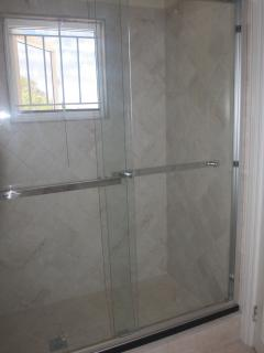 Bathroom with large walk in glass fronted shower cubicle