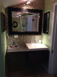 Bathroom 1 with Kohler floating vanity with Lava stone counter