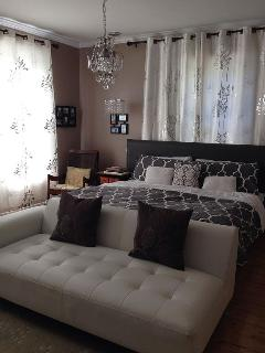master bedroom with king size bed (baby crib available)