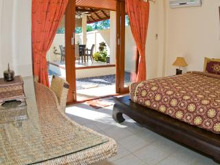 BEDROOM 1 VIEW OUT ON TO THE POOL