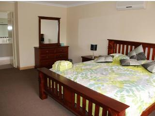 Master Bedroom with King bed, 2 bedsides, Large dressing table and mirror