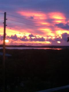 Watch the sunrise over Elizabeth Harbour from the front deck!