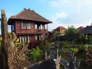 Beautiful wooden house in Ubud rice fields