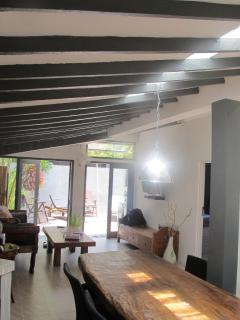 Air conditioned living room and kitchen, wall TV cable, large sofa, huge dining table