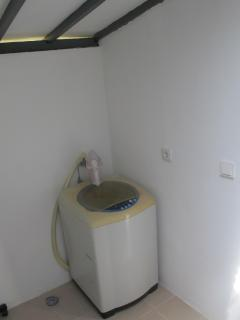 Laundry room with washing machine, iron, iron board
