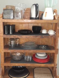 Kitchen cabinet: water boiler, jar, blinder, glass ware, bowls, salad bowl, plates, placemats etc..