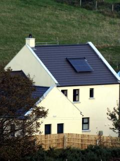 Distant view of the Eco-Loft showing Solar Water heating array.