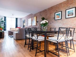 Authentic brick wall. Very big open space (living room, dining area and kitchen are all open space)