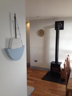 Log Burner in the kitchen / dining area - warm and inviting after a walk on the beach