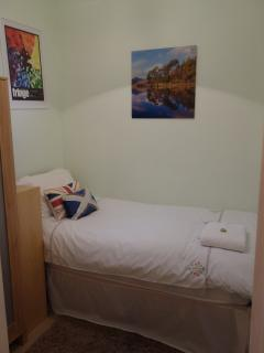 Quiet cosy single room with wardrobe and bedside table