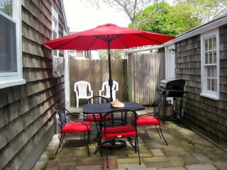 patio with table and chairs and barbecue - to right is 2 car garage where you can keep your bikes - 15 Park Place Harwich Port Cape Cod New England Vacation Rentals