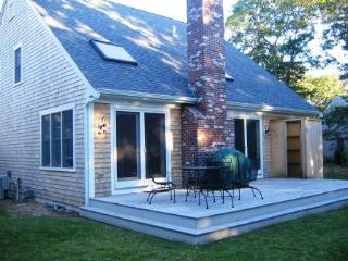 Back deck with outdoor seating - 22 Charlene Lane Harwich Cape Cod New England Vacation Rentals