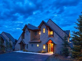 Escape to Big Sky in this End Unit Saddle Ridge Townhome