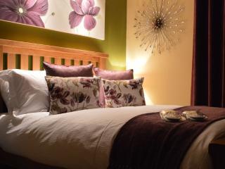 The elegant master bedroom at Monkgate Cloisters