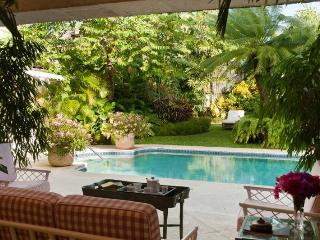 Grand 5 bedroom colonial style home surrounded by lush tropical gardens and great access to the nearby beach, Maynards