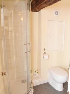 Modern shower room with complimentary toileteries
