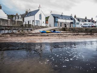 View of the house from the harbour. A safe sandy area for children.