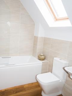 Family bathroom with bath/ integral shower