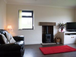 Lounge with wood burner and comfy leather sofas. Plus stunning views from the picture windows.