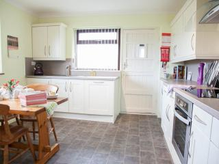 Chat and dine in the kitchen dining room - that looks out onto Pendle Hill and Sabden Valley;